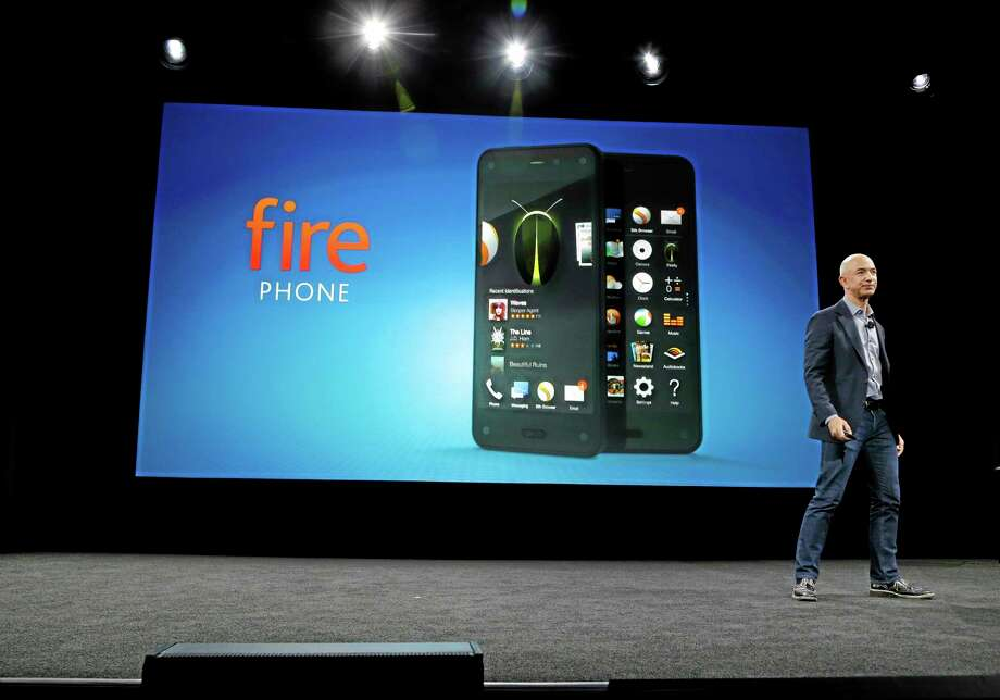 Amazon CEO Jeff Bezos introduces the new Amazon Fire smartphone, Wednesday, June 18, 2014, in Seattle. (AP Photo/Ted S. Warren) Photo: AP / AP