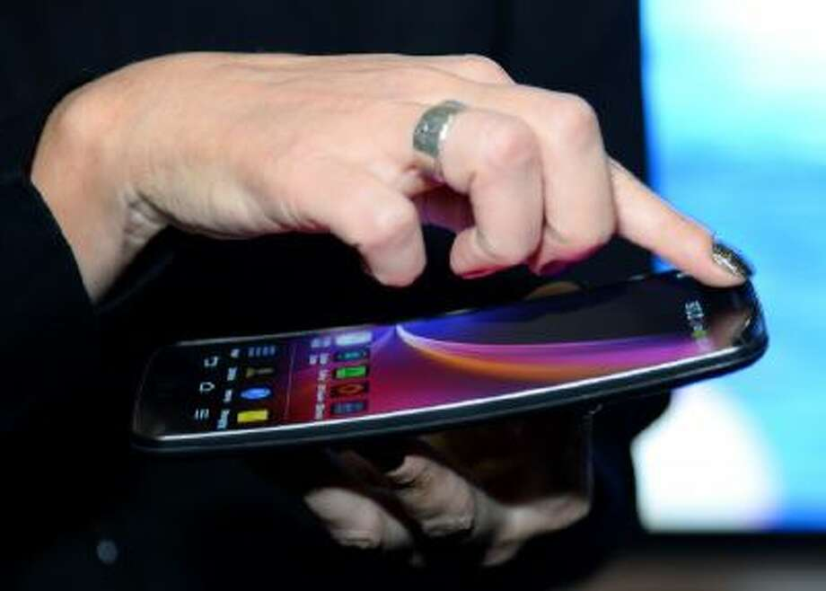 The LG Electronics LG G Flex phone is shown at a press event at the Mandalay Bay Convention Center for the 2014 International CES on January 5, 2014 in Las Vegas, Nev.