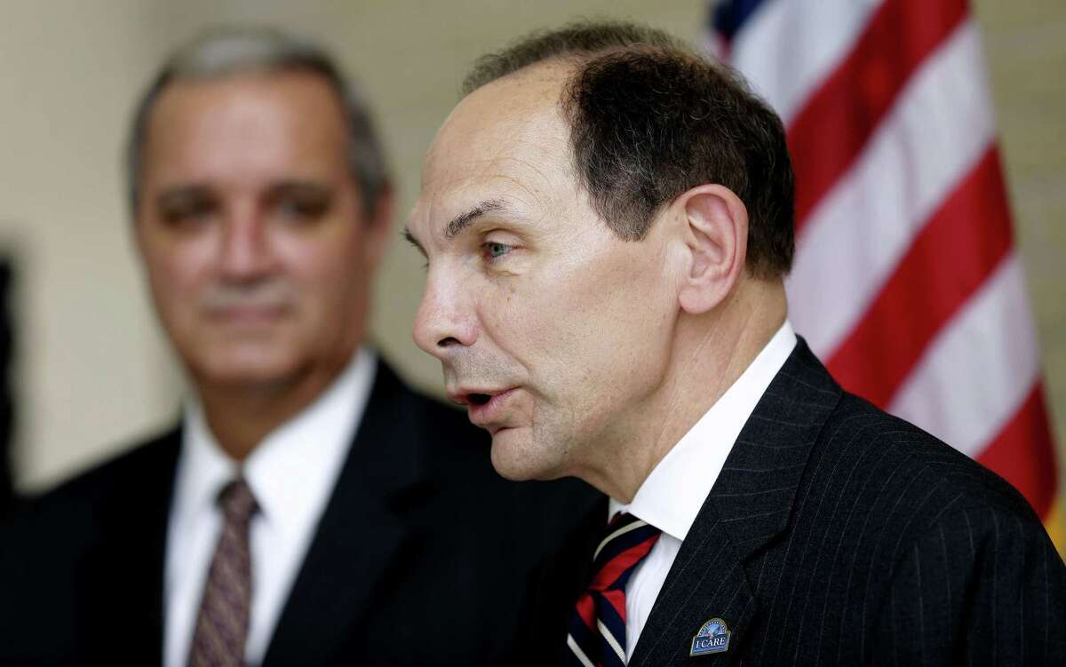 In this photo taken Oct. 1, 2014, Veterans Affairs Secretary Robert A. McDonald, right, accompanied House Veterans Affairs Committee Chairman Rep. Jeff Miller, R-Fla., speaks in Tampa, Fla.
