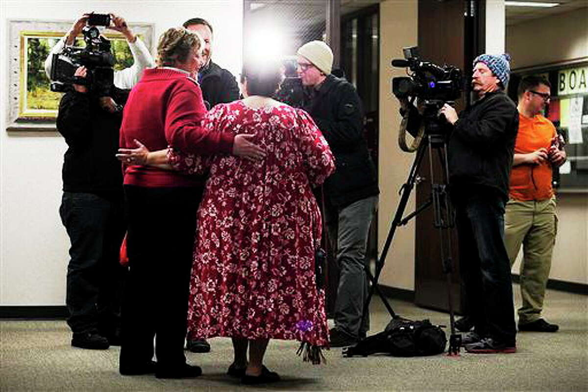 In this photo taken on Thursday, Dec. 26, 2013, Cheryl Haws, left, and her partner Shelly Eyre hold each other while being interviewed by the media after their marriage license issued at the Utah County Clerk's office in Provo, Utah. The state plans to ask the U.S. Supreme Court to step in and put a halt to gay marriages while they appeal a federal judge's ruling overturning the ban. (AP Photo/The Daily Herald, Mark Johnston) MANDATORY CREDIT