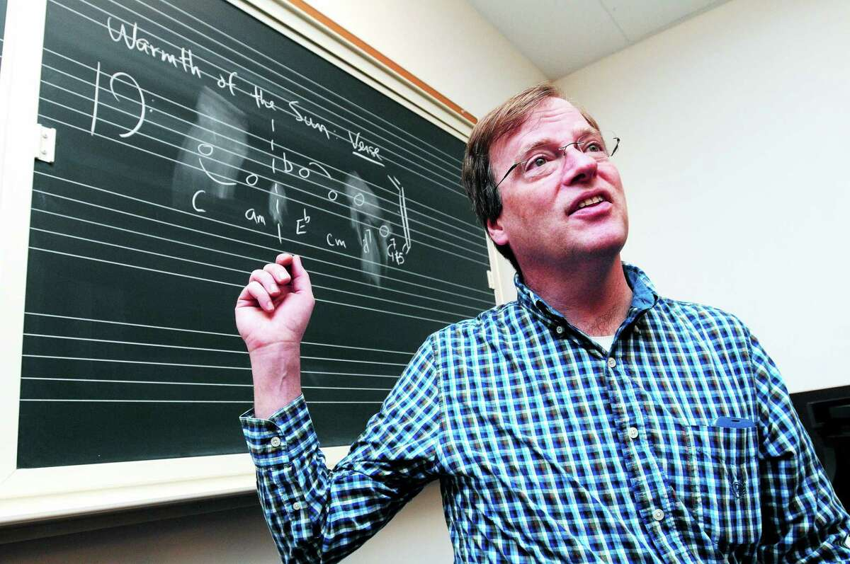 Yale University music theory professor Daniel Harrison talks about the Beach Boys at Stoeckel Hall in New Haven recently.