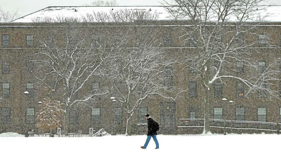 Catherine Avalone/The Middletown Press A student walks along College Row at Wesleyan University Friday afternoon during the blizzard Nemo. Photo: Journal Register Co. / TheMiddletownPress