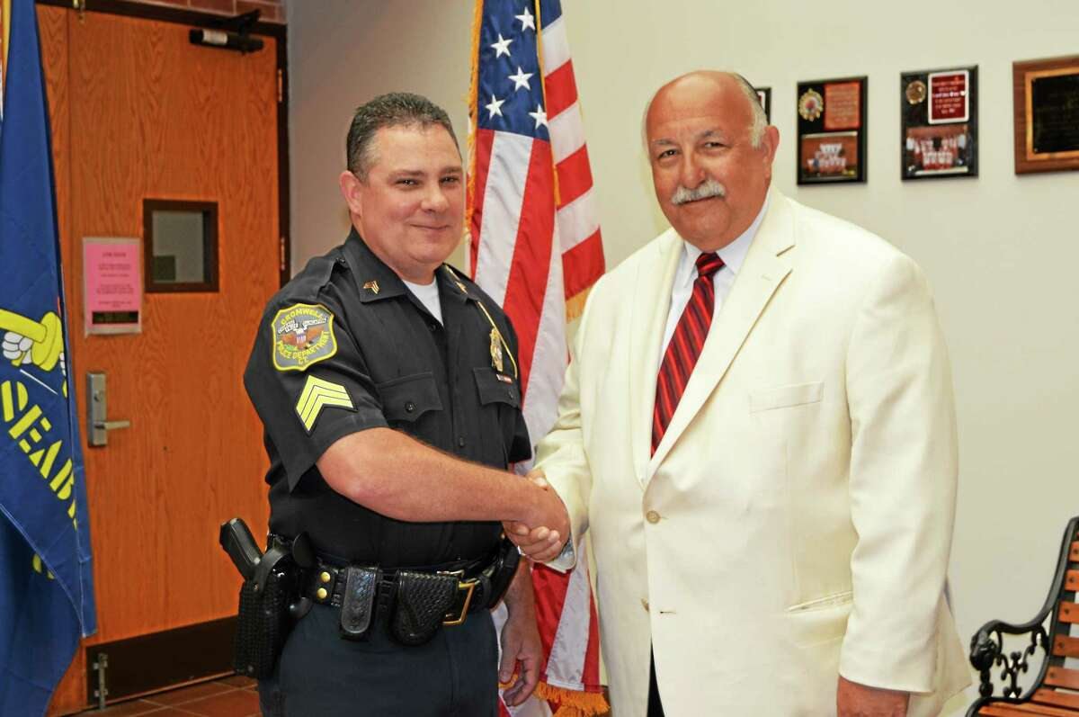 Sgt. Steve Penn, left, and Cromwell Police Capt. Anthony Salvatore