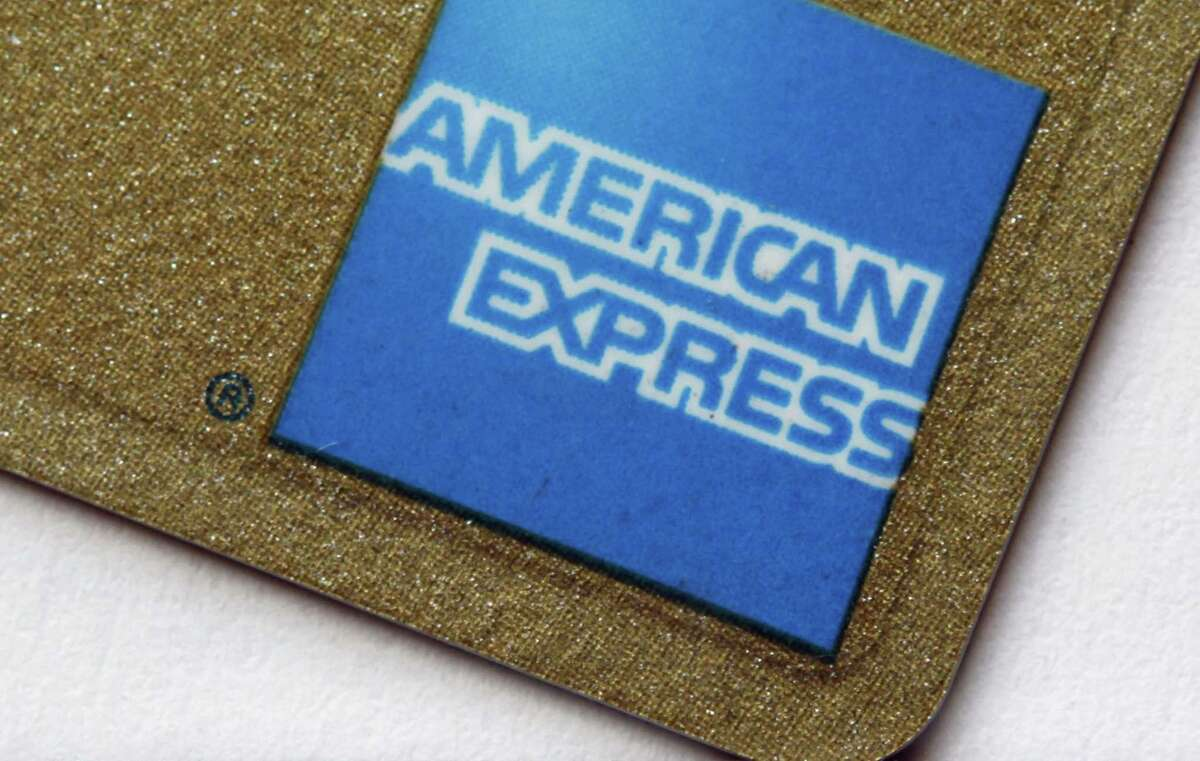 FILE - This Tuesday, Jan. 17, 2012 file photo shows the corner of an American Express card in Surfside, Fla. A judge on Thursday, Feb. 19, 2015 ruled that American Express violated U.S. antitrust laws by barring merchants from asking customers to prefer one credit card over another.