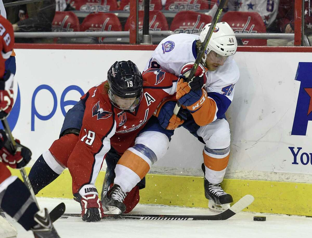 Capitals center Nicklas Backstrom (19) battles New York Islanders center Kael Mouillierat (48) for the puck during the first period of Saturday's game in Washington.