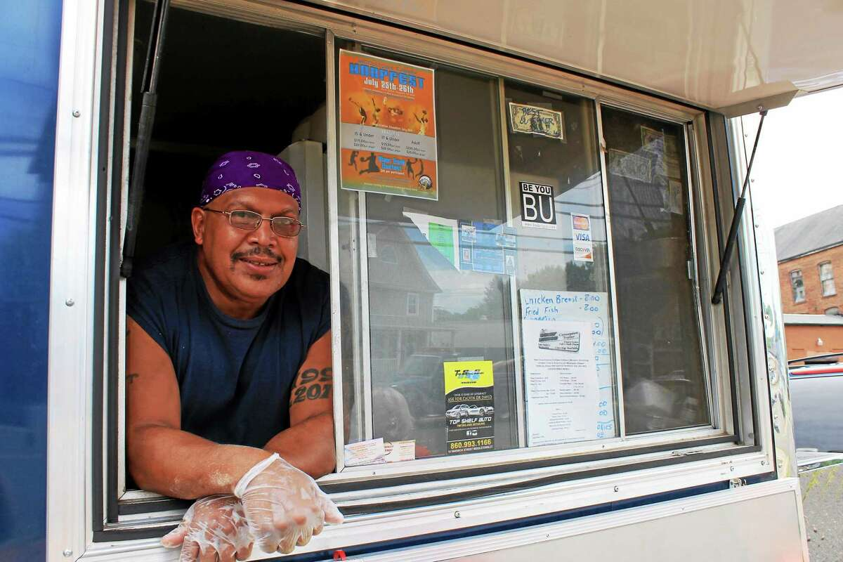 Former truck driver Kasto Mabery of Kickin' Chicken runs the popular food truck in Middletown which sets up along Main Street Extension.