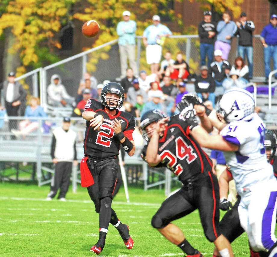 Wesleyan senior quarterback Jesse Warren fires a pass against Little Three rival Amherst last Saturday on Andrus Field. Photo: Jimmy Zanor — Middletown Press