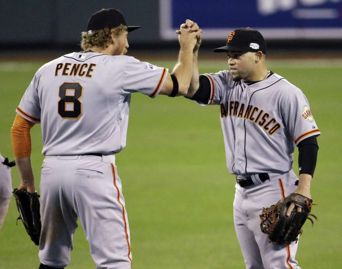 San Francisco Giants' Gregor Blanco and Juan Perez celebrate after Game 1 of the World Series against the Kansas City Royals. The Giants won 7-1 to take a 1-0 lead.