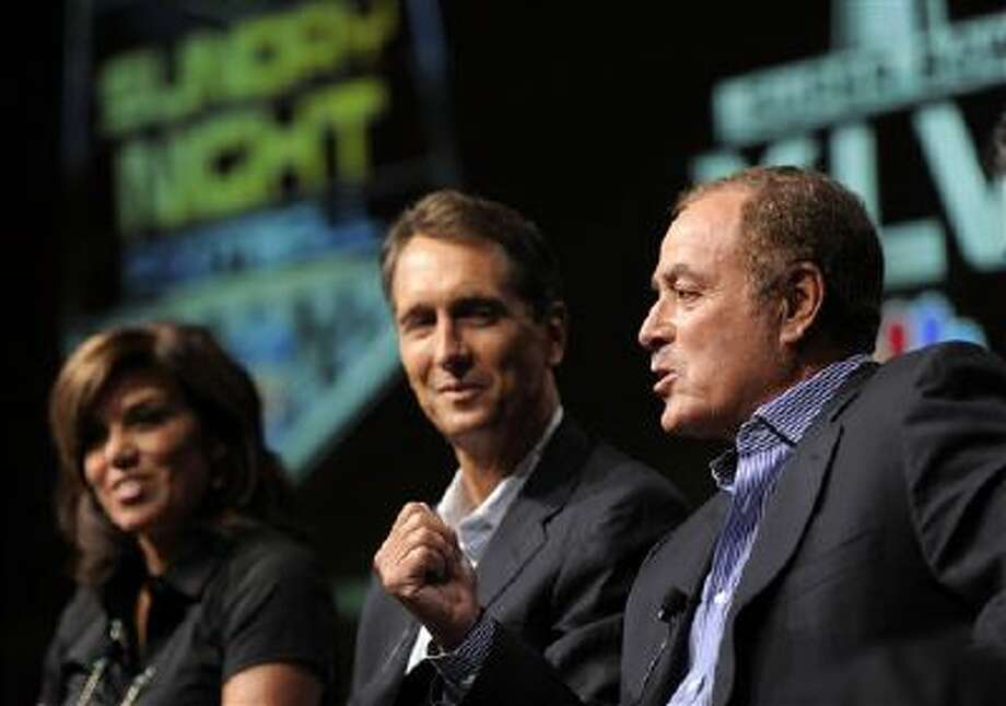 "Al Michaels, right, play-by-play commentator for ""Sunday Night Football,"" takes part in a panel discussion on the show with game analyst Chris Collinsworth, center, and sideline reporter Michele Tafoya at the NBC Universal summer press tour, Monday, Aug. 1, 2011, in Beverly Hills, Calif. Photo: AP / AP"