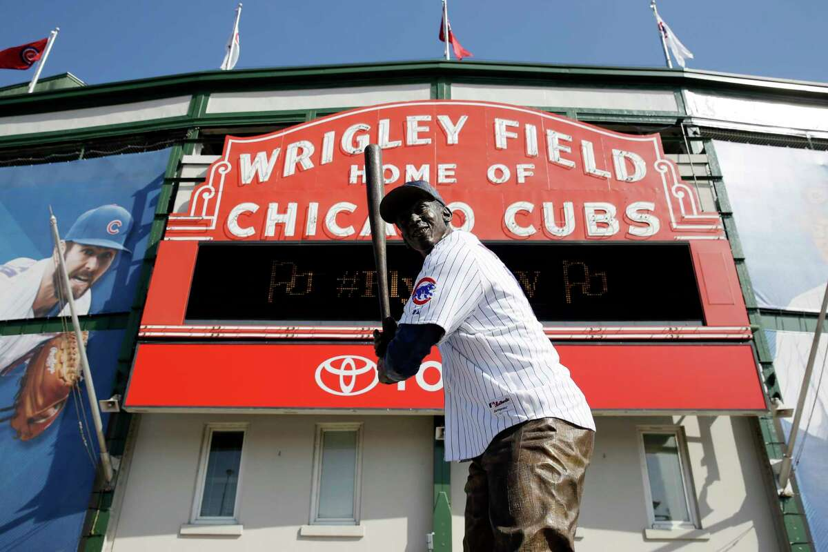 Ernie Banks' statue wears a Chicago Cubs jersey at Wrigley Field in Chicago.