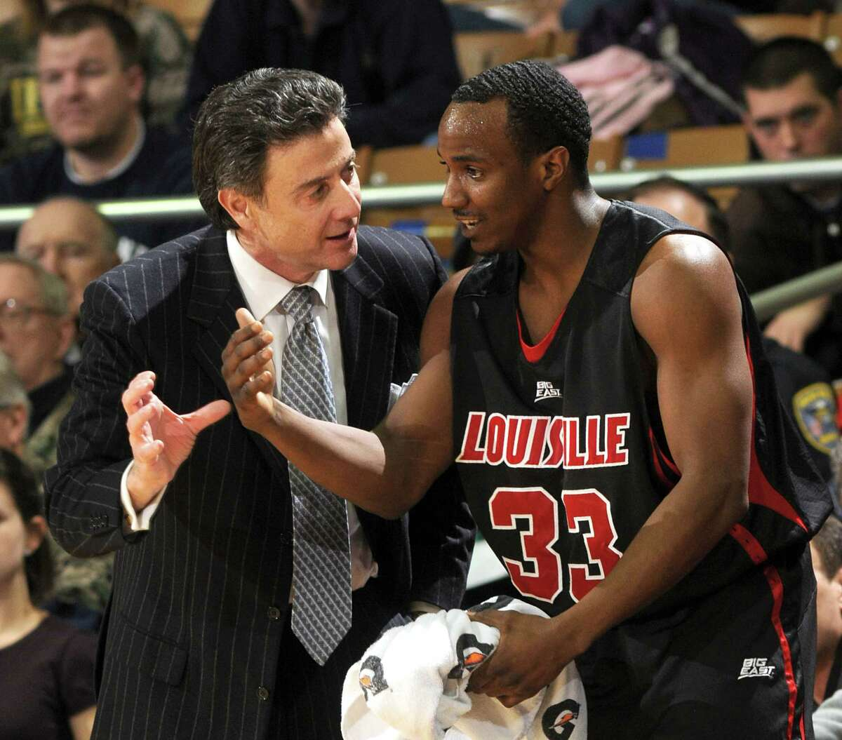 In this Feb. 12, 2009 file photo, Louisville coach Rick Pitino, left, talks with guard Andre McGee.