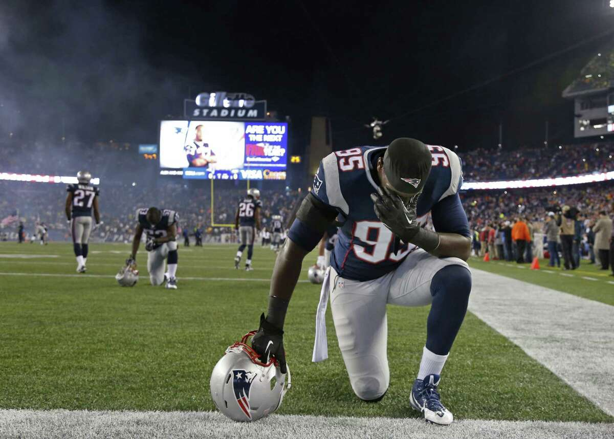 New England Patriots defensive end Chandler Jones (95) takes a moment before last Thursday's game against the New York Jets in Foxborough, Mass.
