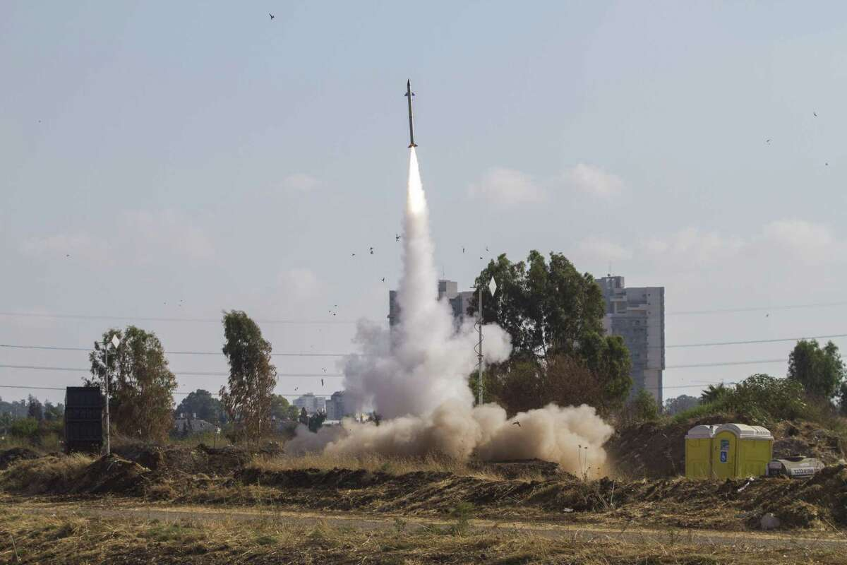 FILE - In this July 9, 2014 file photo, an Iron Dome air defense system fires to intercept a rocket from the Gaza Strip in Tel Aviv, Israel. A much-awaited United Nations report into the 2014 Gaza war released Monday, June 22, 2015, found that both Israel and Palestinian militant groups may have committed war crimes during the conflict.