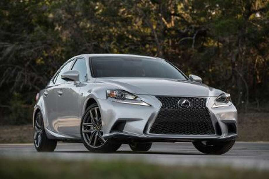 The Toyota Motor Corp. 2014 Lexus IS sport sedan is seen on a road in this handout photo taken in Austin, Texas, U.S., on Thursday, March 5, 2013. The 2014 IS arrives mid-year with features derived from an intense racetrack analysis with its German rivals.