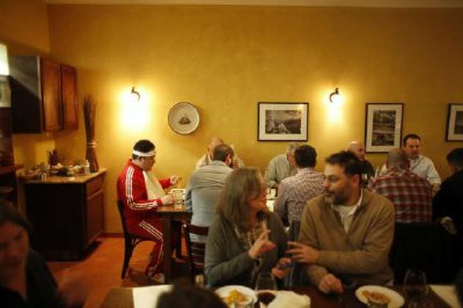 Restaurant patrons chat and joke during the 40 course feast called Panarda at restaurant La Virtu, in Philadelphia.