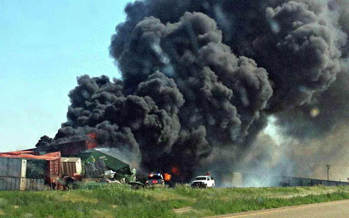 Smoke rises from two cargo trains that collided two miles east of Goodwell, Okla., on June 24, 2012.