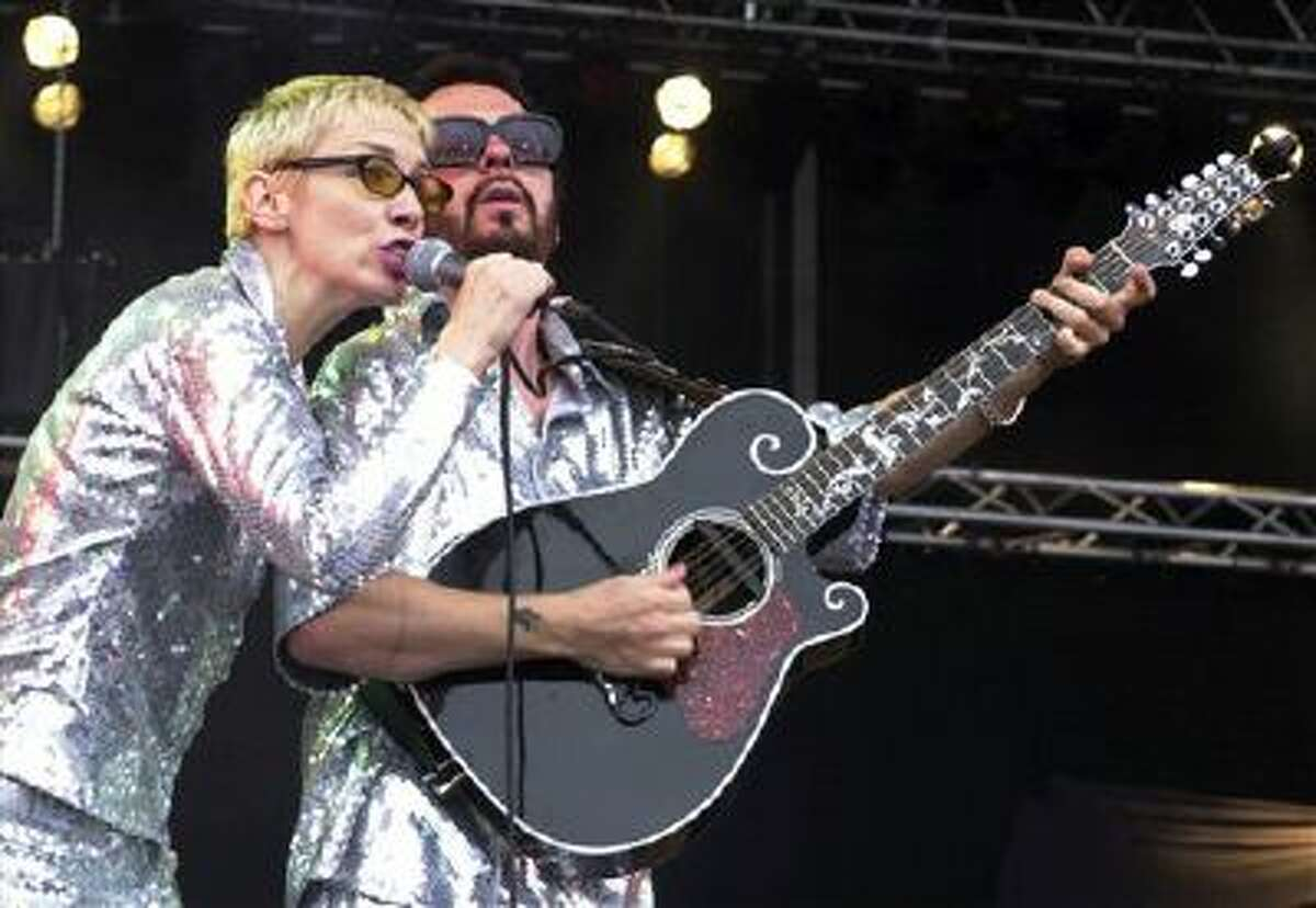 This June 10, 2000, file photo shows Annie Lennox, left, and Dave Stewart as the Eurythmics performing on stage at the Rock at the Ring three-day music festival at the Nuerburgring race circuit in Nuerburg, Germany.