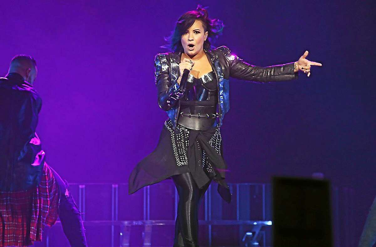 Photo by John Atashian Actress, singer and songwriter Demi Lovato is shown performing during her sold out show at the Mohegan Sun Arena in Uncasville on Oct. 17. She is on tour in support of her 4th studio album ìDemiî.