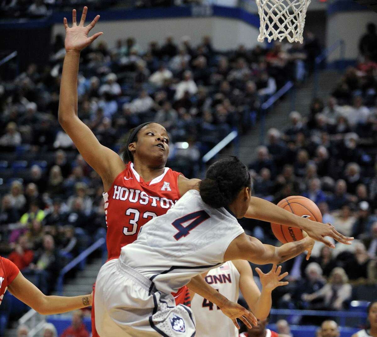 UConn point guard Moriah Jefferson passes around Houston's Tyler Gilbert during the first half of the Huskies' win on Tuesday night at the XL Center in Hartford.