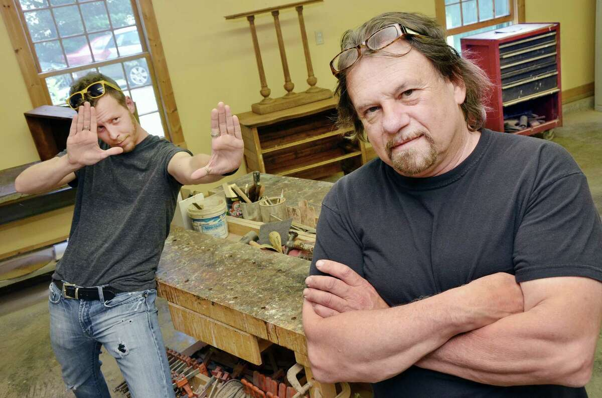Catherine Avalone — The Middletown PressChristopher Symington of Durham featured David Fugge, right, owner of David M. Fugge Furniture Restoration at 328 Main St. in Durham, in a short film for his senior project at Southern Connecticut State University in 2003. Symington lost the 18-minute film showing Fugge working in his shop, going to auctions, and interacting with clients but the film has resurfaced 11 years later.