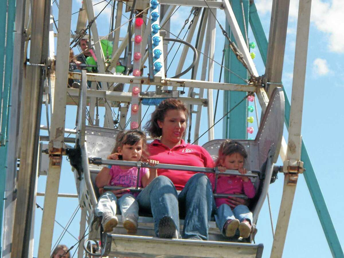 File photo A mother and children ride the Ferris wheel.