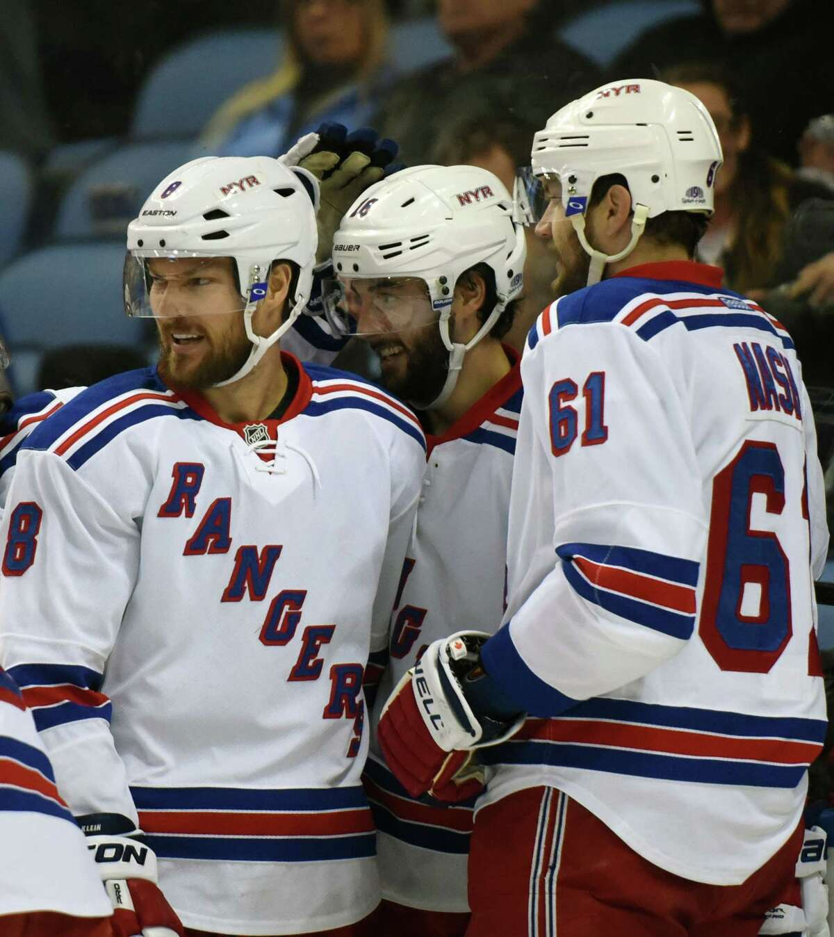 The New York Rangers' Kevin Klein (8), Derick Brassard (16) and Rick Nash (61) celebrate a goal by Nash during the second period of their 3-1 win over the Sabres on Friday night in Buffalo, N.Y.
