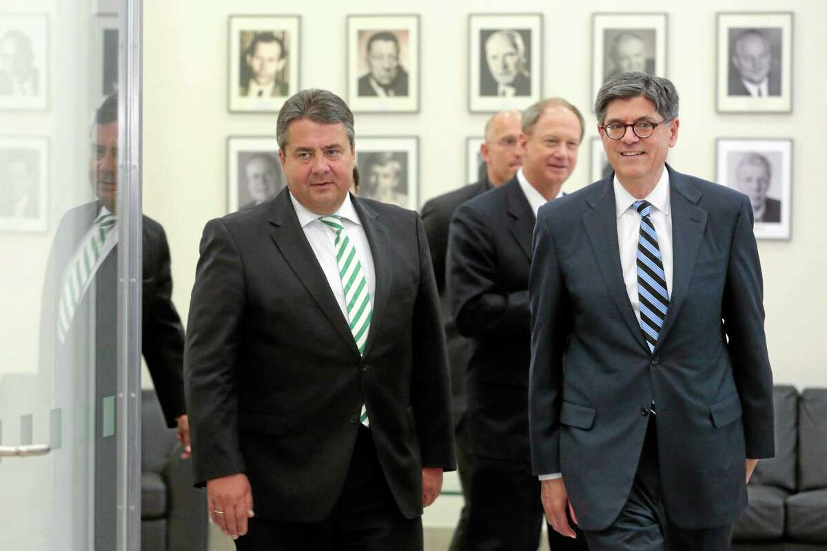 United States Secretary of the Treasury Jack Lew, right, and German Vice Chancellor and Minister for Economy and Energy Sigmar Gabriel, left, arrive for a news conference after a meeting in Berlin, Thursday, June 19, 2014. (AP Photo/Markus Schreiber)