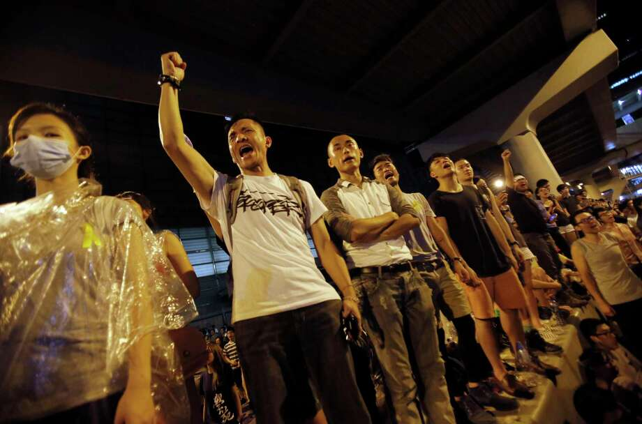 Protesters cheer on the announcement of the official occupation of streets surrounding government headquarters in Hong Kong, China, in this file photo. Photo: Associated Press  / AP
