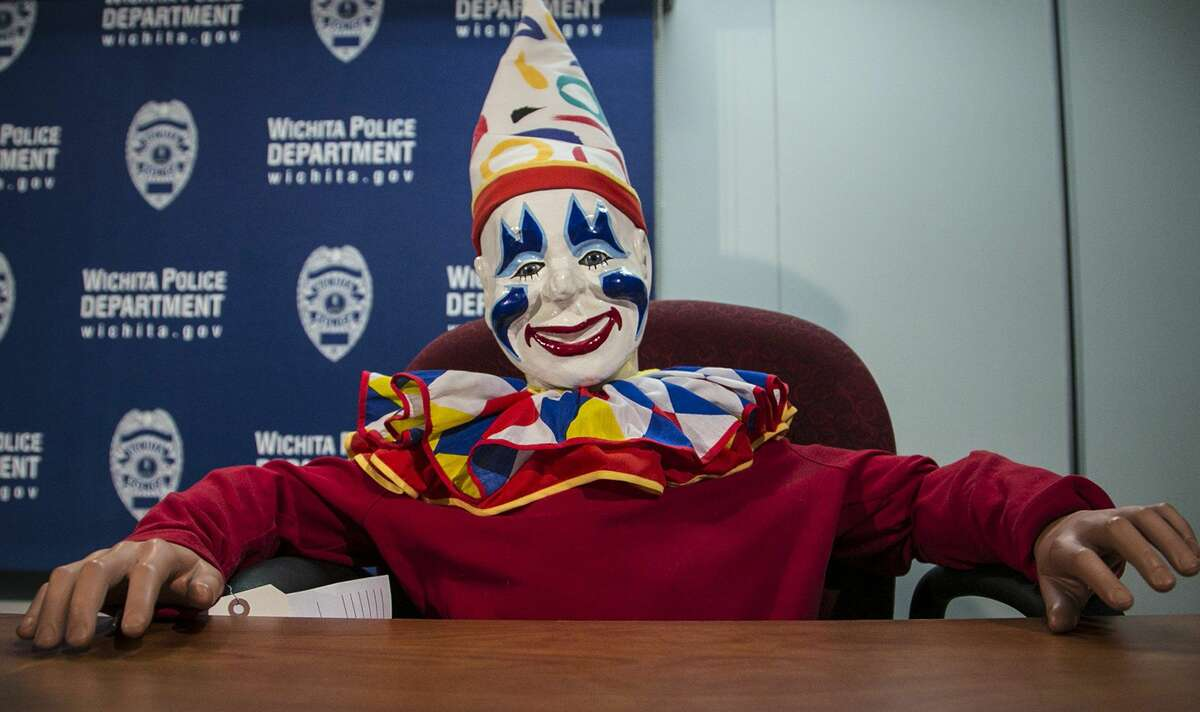 Joyland's organ-playing mascot Louie the Clown appears at a daily police briefing in the Wichita City Hall police headquarters, Thursday, Feb. 19, 2015, in Wichita, Kan. Louie, who went missing from a closed Wichita amusement park more than a decade ago, was found at the home of a sex offender who used to work at the park. (AP Photo/The Wichita Eagle, Mike Hutmacher) LOCAL TELEVISION OUT; MAGS OUT; LOCAL RADIO OUT; LOCAL INTERNET OUT