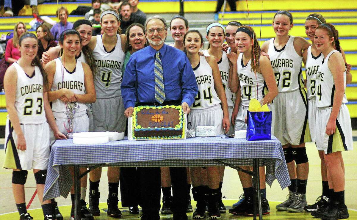 Eric Anderson — Special to Middletown Press Haddam-Killingworth girls basketball coach Jim Bombaci, assistant coach Ann Anderson and the Cougars celebrate following Bombaci's 500th career victory Saturday at the H-K Fieldhouse. H-K defeated Hyde, 66-44.