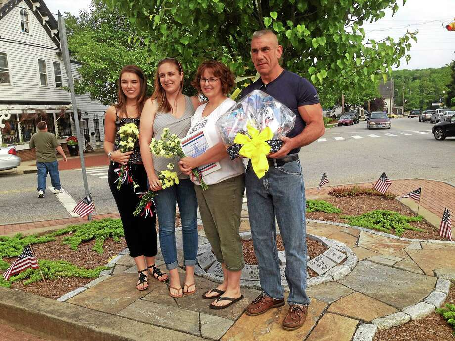 From left are Megan, Caitlin, Susan and Jeff Beebe of East Hampton, the family of marine Beebe who was deployed to Afghanistan. Photo: Jeff Mill — The The Middletown Press