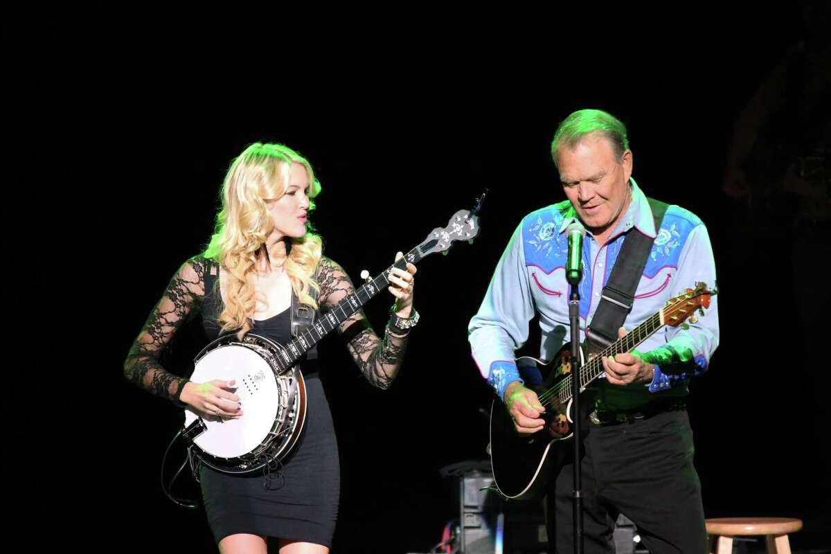 """This photo provided by PCH Films shows, Ashley Campbell, left, and Glen Campbell performing during ìThe Goodbye Tour,î in a scene the documentary film, """"Glen Campbell... I'll Be Me,"""" directed by James Keach. The film is nominated for two Oscars: documentary feature and original song. The 87th annual Academy Awards are presented on Sunday, Feb. 22, 2015. (AP Photo/PCH Films)"""