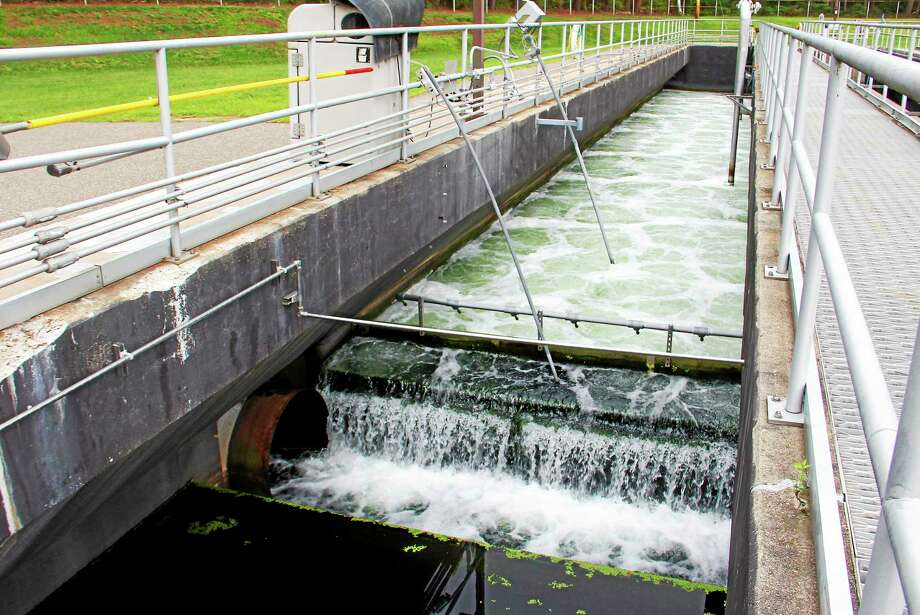 Treated wastewater is discharged from an aeration chamber at the Water Pollution Control Facility in Torrington. The Portland sewage plant was without power for 25 hours this week following massive thunderstorms. The first selectwoman is meeting with Eversource to determine what took place. Photo: File Photo