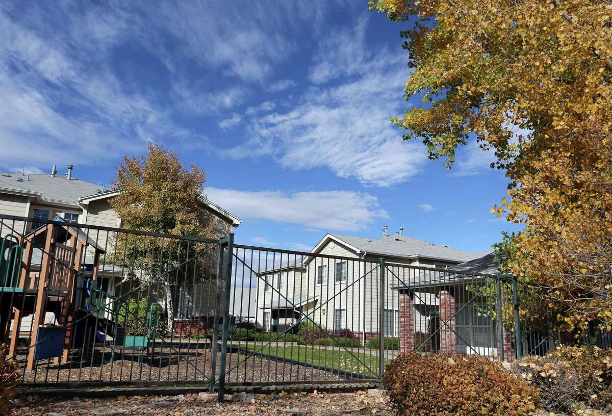 This Wednesday, Oct. 22, 2014, photo shows the apartment complex in Aurora, Colo., which police say is the home of one of the three teenage girls who, according to U.S. authorities, were en route to join the Islamic State group in Syria when they were stopped at an airport in Germany. The two sisters, ages 17 and 15, and their 16-year-old friend have been reunited with their families in Colorado, according to an FBI spokeswoman.