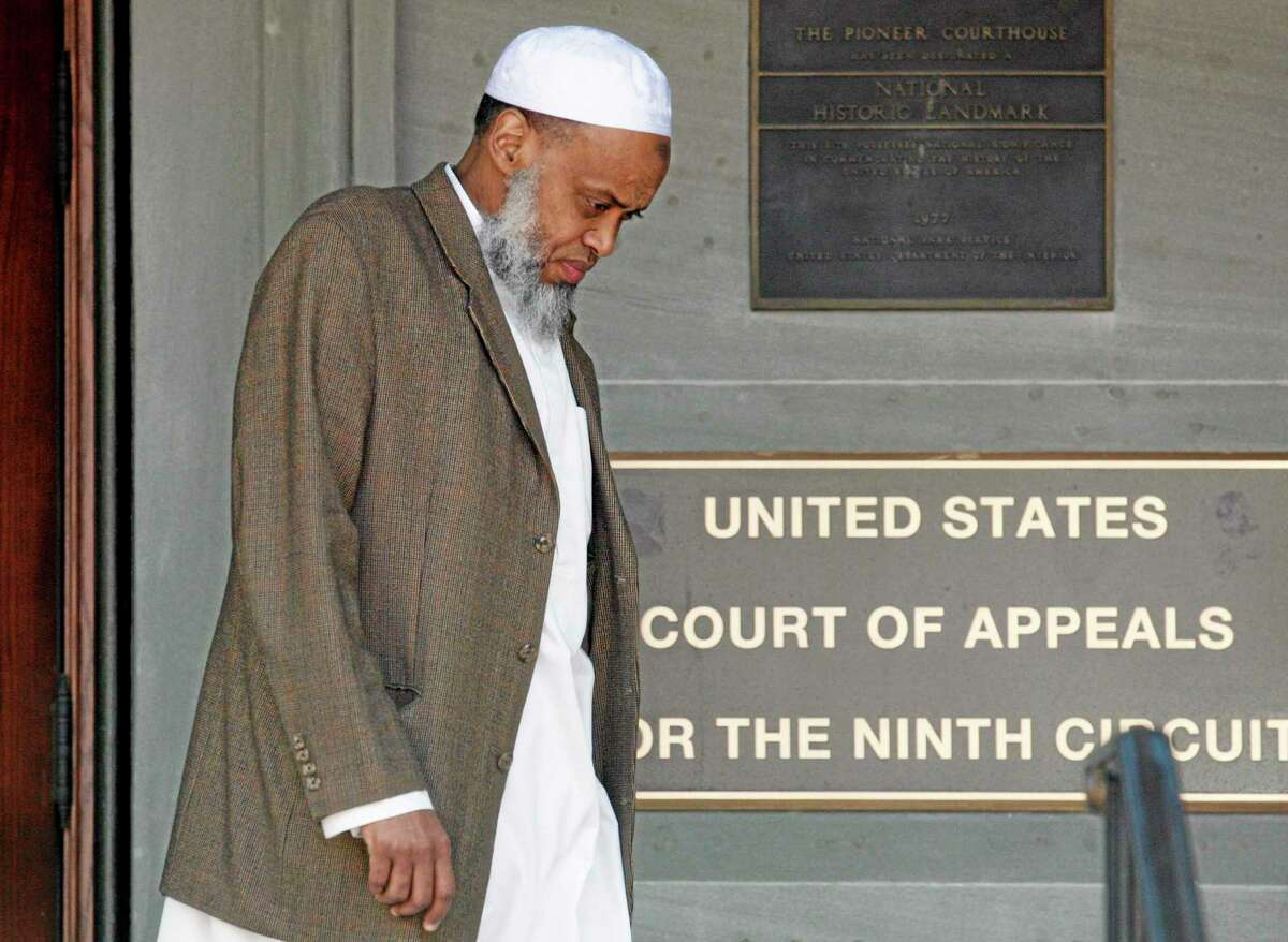 FILE - This May 11, 2012 file photo, Portland Imam Mohamed Sheikh Abdirahman Kariye, who is one of 15 men who say their rights were violated because they are on the U.S. government's no-fly list, leaves the United Sates Court of Appeals following oral arguments on the ACLU No Fly List challenge, in Portland, Ore. A federal judge has ruled Tuesday, June 24, 2014, that the U.S. government violated the rights of 13 people on its no-fly list by depriving them of their constitutional right to travel, and gave them no adequate way to challenge their placement on the list. (AP Photo/Rick Bowmer, File)