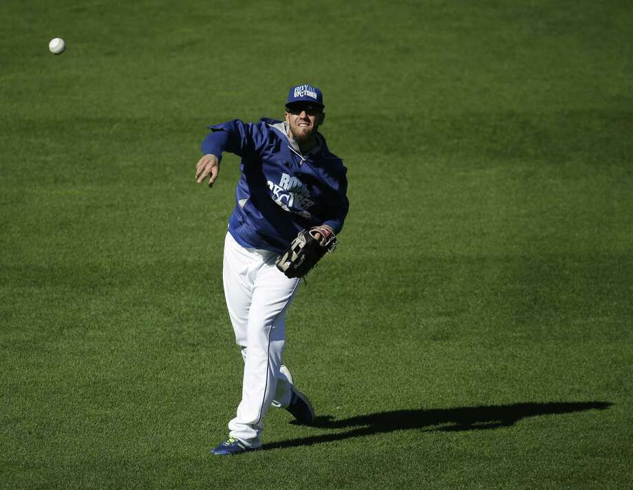 Kansas City Royals starting pitcher James Shields throws during baseball practice Monday, Oct. 20, 2014, in Kansas City, Mo. The Royals will host the San Francisco Giants in Game 1 of the World Series on Oct. 21. (AP Photo/Charlie Riedel) Photo: The Associated Press  / AP