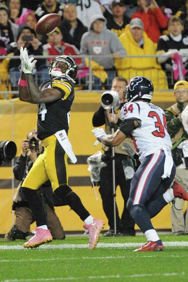 Pittsburgh Steelers wide receiver Antonio Brown (84) tries  to make a catch past Houston Texans cornerback A.J. Bouye (34) in the fourth quarter of the NFL football game against the Pittsburgh Steelers, Monday, Oct. 20, 2014, in Pittsburgh. The catch was ruled out of bounds and overturned on replay. (AP Photo/Don Wright) Photo: AP / FR87040 AP