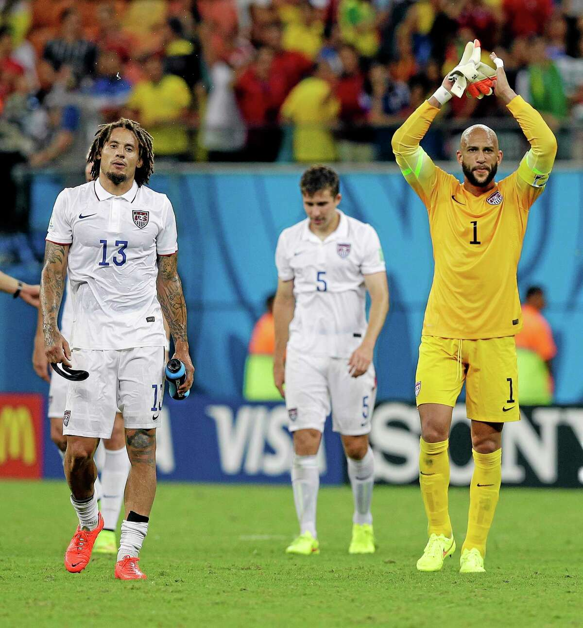 United States' goalkeeper Tim Howard and United States' Jermaine Jones walk off the pitch following their 2-2 draw with Portugal on Sunday.