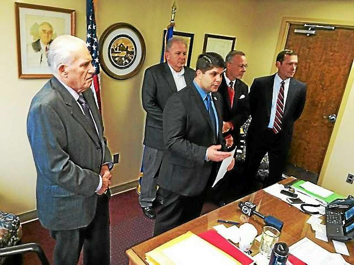 Mayor Daniel Drew (center) announced a plan for a six-story apartment tower adjacent to the MiddleOak building on Court Street. From left, Middlesex County Chamber of Commerce President Larry McHugh, Comeau & Kelly builders President Dan Kelly, architect Jeffrey Bianco and MiddleOak Vice President Tom Ford joined the press conference.