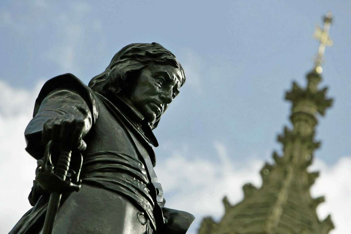 The statue of Oliver Cromwell which represents the Lord Protector of England in 1658, outside the Palace of Westminster, in central London.