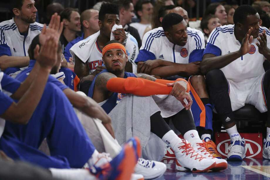 Knicks forward Carmelo Anthony, center, reacts alongside his teammates in the final minutes of Monday's preseason game against the Milwaukee Bucks at Madison Square Garden in New York. Photo: John Minchillo — The Associated Press  / FR170537 AP