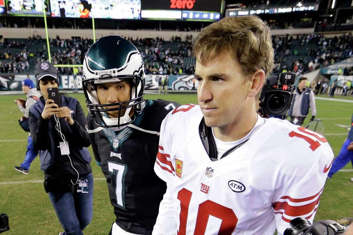 Eagles quarterback Sam Bradford (7) and Giants quarterback Eli Manning walk on the field after Monday's game. The Eagles won 27-7.