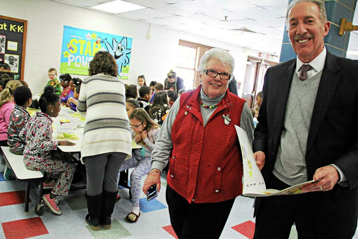 Kathleen Schassler — The Middletown Press Rotary members Patti Anne Vassia and probate Judge Joseph Marino visit students at Macdonough Elementary School on Friday in Middletown.