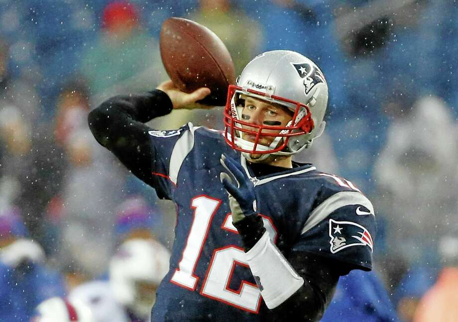 Tom Brady and the Patriots won't know their opponent for next Saturday's divisional game until after Sunday's Chargers-Bengals game. Photo: Elise Amendola — The Associated Press  / AP