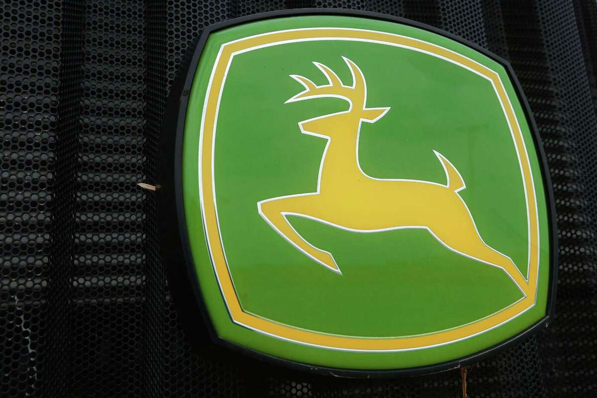FILE - This June 8, 2014 file photo shows the John Deere farming logo at a farming equipment dealership in Petersburg, Ill. Deere & Co. reports quarterly financial results before the market opens Friday, Feb. 20, 2015.