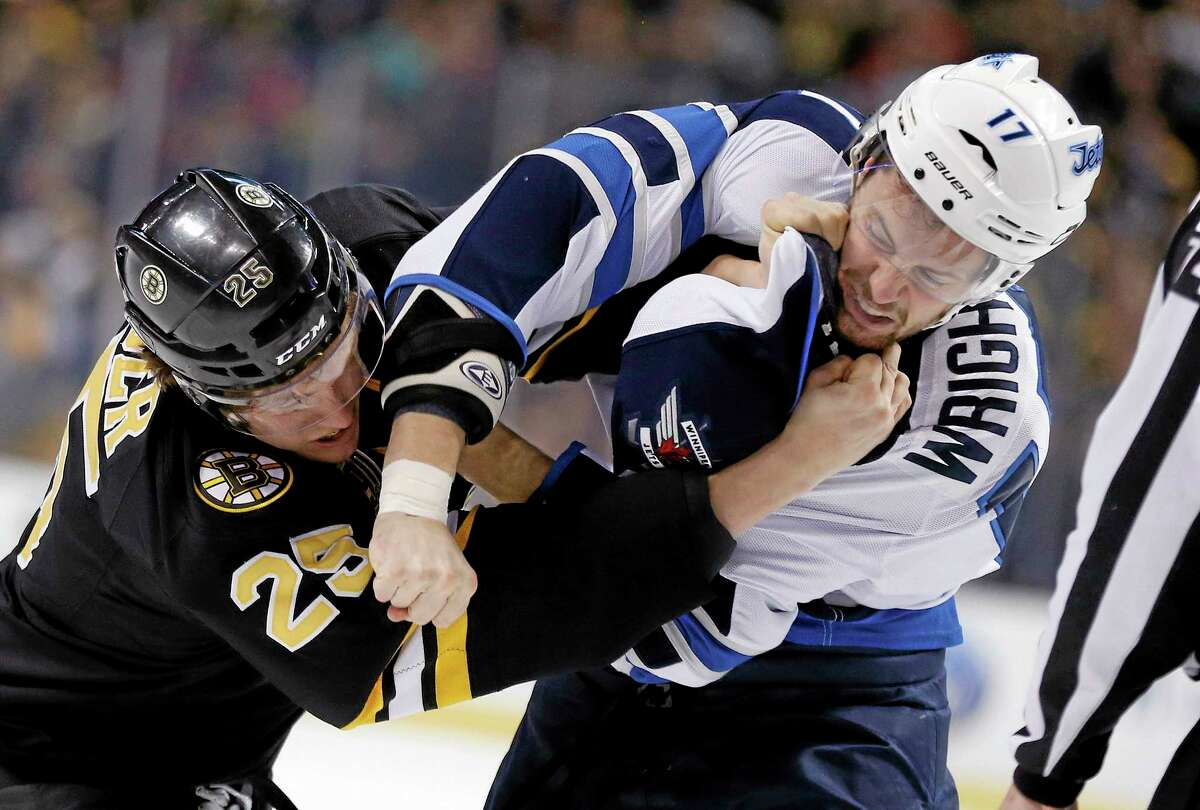Matt Fraser and the Winnipeg Jets' James Wright fight during the first period of the Bruins' 4-1 win on Saturday afternoon in Boston.