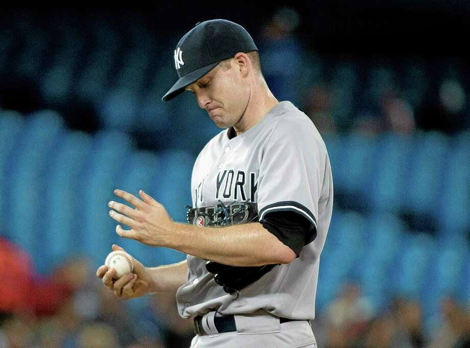 Yankees starting pitcher Chase Whitley reacts during the second inning Monday against the Blue Jays. Photo: Nathan Denette — The Associated Press  / The Canadian Press