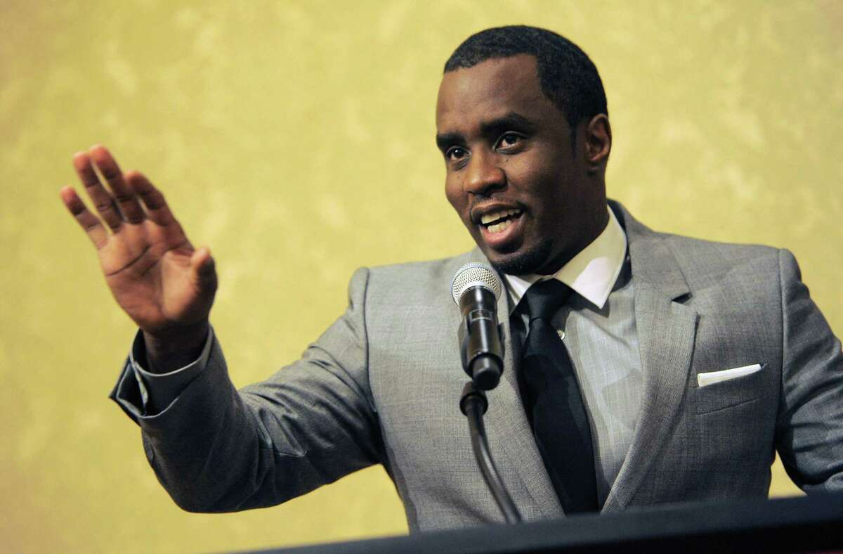 """In this July 26, 2013 photo, Sean """"Diddy"""" Combs of the new network Revolt TV addresses reporters at the Beverly Hilton Hotel in Beverly Hills, Calif."""