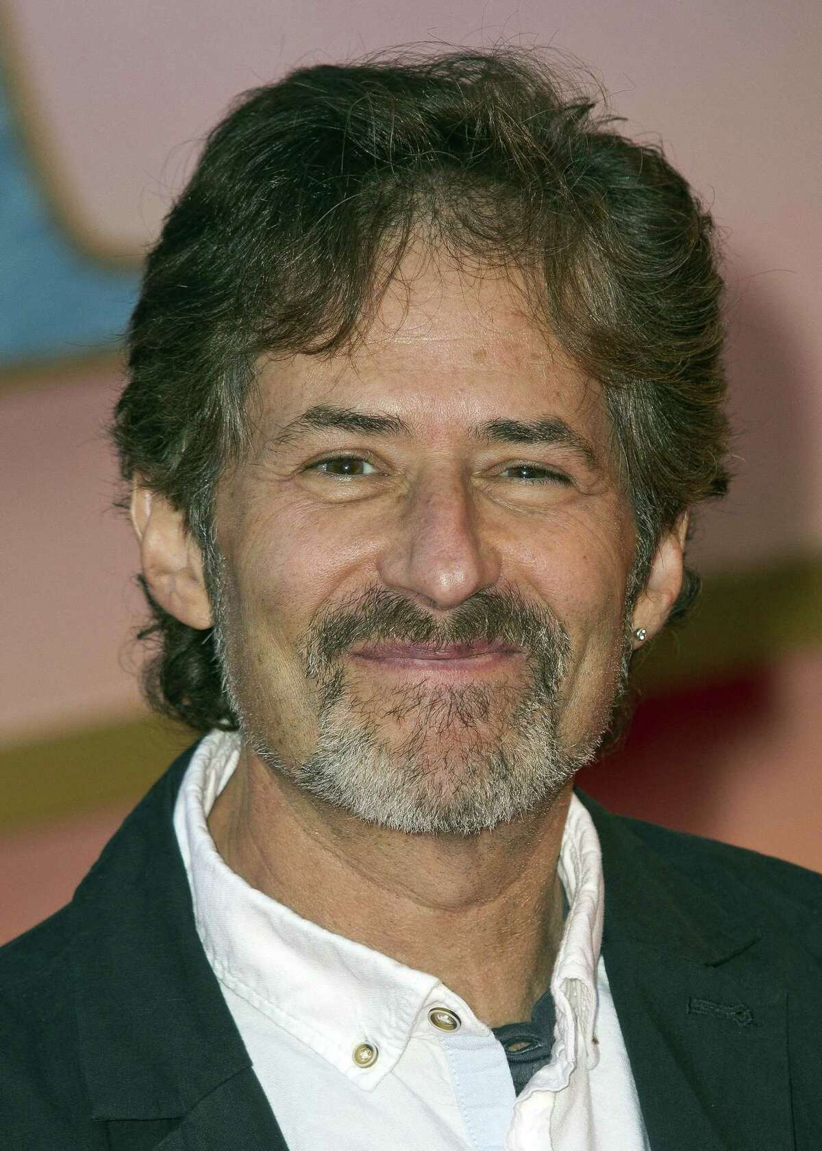 In this March 27, 2012 photo, composer James Horner arrives at the 'Titanic 3D' UK film premiere at the Royal Albert Hall in Kensington, West London.