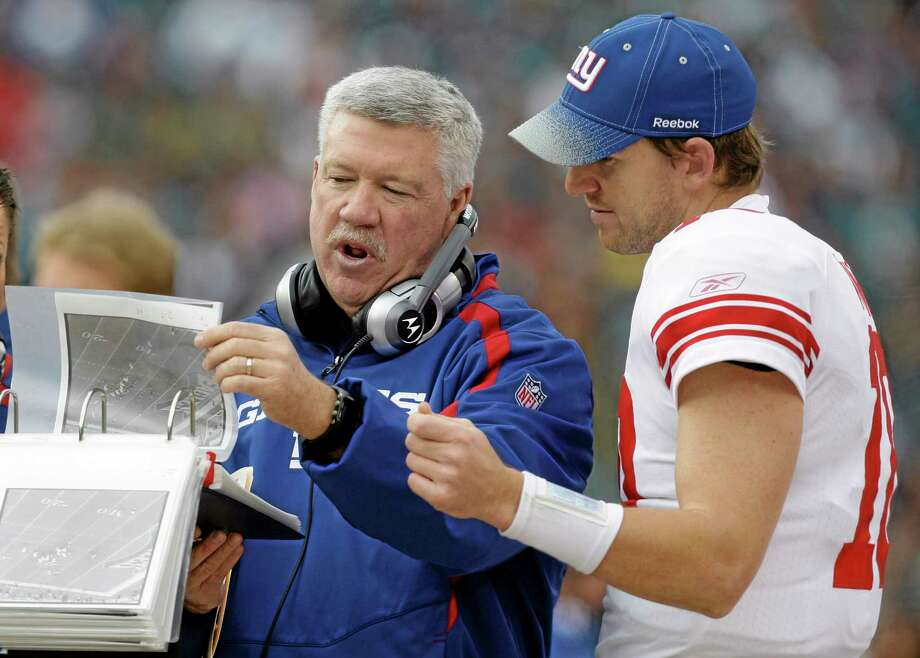 Despite many Giants fans' obvious recent disdain for North Haven native and New York offensive coordinator Kevin Gilbride, Register sports columnist Chip Malafronte feels Big Blue supporters will eventually come around. After all, winning two Super Bowls can do wonders for a coach's legacy. Photo: Carolyn Kaster — The Associated Press  / AP
